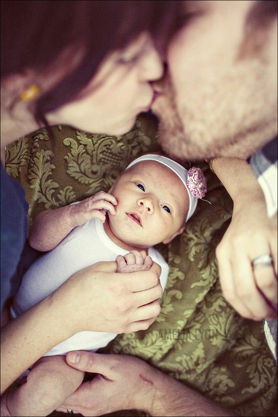 Family and newborn photo idea with Kennedi kissing Grant's head