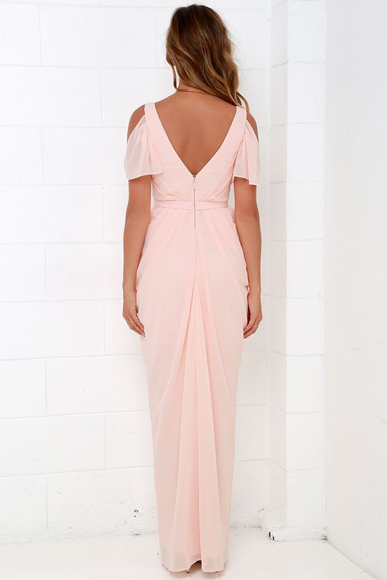 Whether you're two-stepping or taking the stage by storm, all eyes will be on you in the Bariano Graze-ful Dancer Peach Maxi Dress! Lightweight chiffon forms fluttering cold shoulder sleeves, framing an intricately pleated bodice with a surplice front, lightly padded cups, and V back. Banded waist precedes a pleated, wrapping maxi skirt with draping sides, from which a shiny silver mini skirt peeks out. Hidden back zipper with clasp. Fully lined. Self: 100% Polyester. Lining: 97% Polyester…