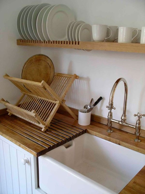 tiny kitchen, most frequently used dishes stored in drying rack right above sink.