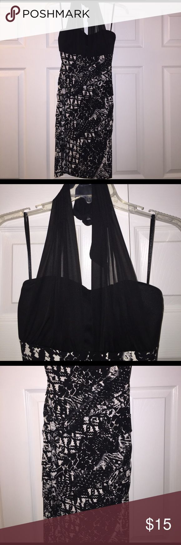 Black and white mini dress Black and white bottom with black top, dress also has sheer halter to go over the front and ties around next. Great dress for a girls night out! Excellent condition! Carole Little Dresses Mini