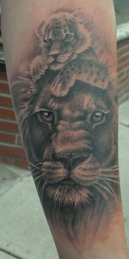 Lion and cub design by Joe King