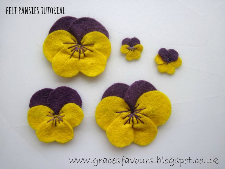 Felt DIY Pansy Flower Bookmark Tutorial - I just love cute pansy faces and all I can sew is a button, so this one might just be in my skill range (LOL) - so cute - so many ways to use them - and templates are included