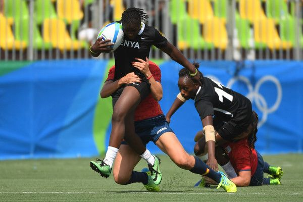 Kenya's Janet Okelo is tackled in the womens rugby sevens match between Spain and Kenya during the Rio 2016 Olympic Games at Deodoro Stadium in Rio de Janeiro on August 7, 2016. / AFP / Pascal GUYOT