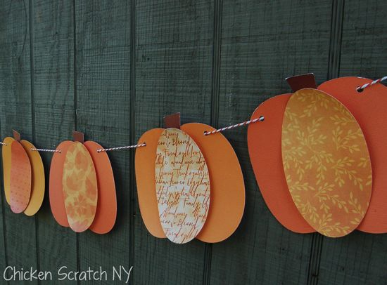 Oval cutouts from different shades & designed scrapbook paper to make pumpkins! I love this! I think I need to do this with smaller ovals for little pumpkins to hang up on a ledge at work