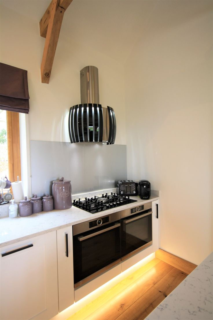 Two Neff single ovens and gas hob, finished off with a Falmec Prestige extractor hood, which is a lovely feature.