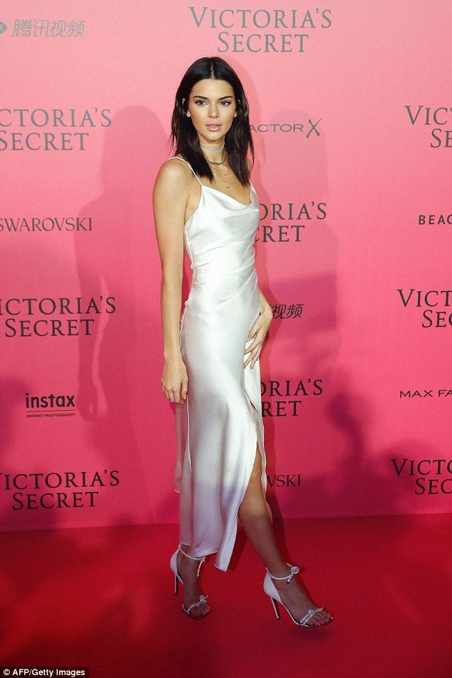 Gorgeous: Kendall Jenner made an appearance after the show in a striking cream slip, looki...