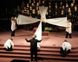 Even in a small congregation, you can do this. Perhaps bring the 2 strips of cloth over the heads of the congregation, moving to the front, then form the shape of the cross....