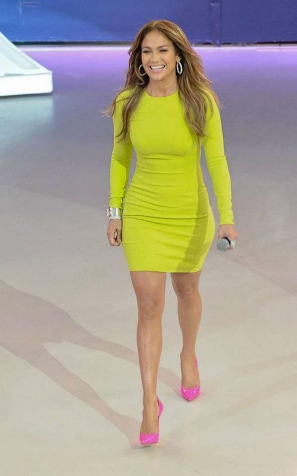 in neon yellow dress and neon pink shoes