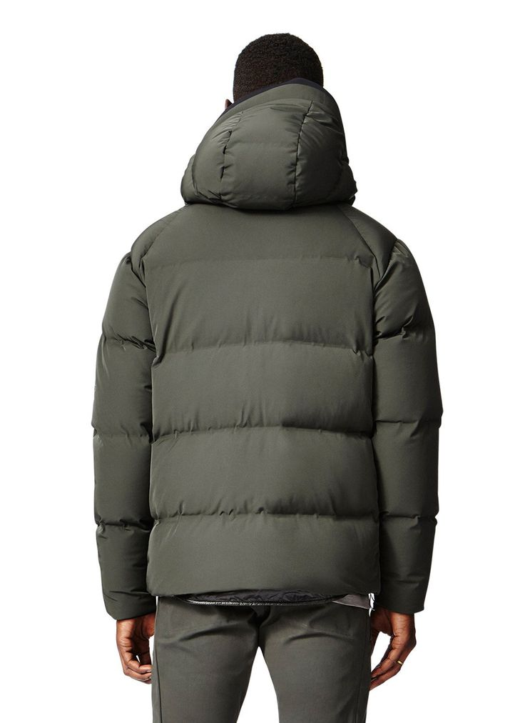 ... the down channels of this hooded jacket are fused together, sans  sewing, to maximize water-resistance and prevent any down for escaping.