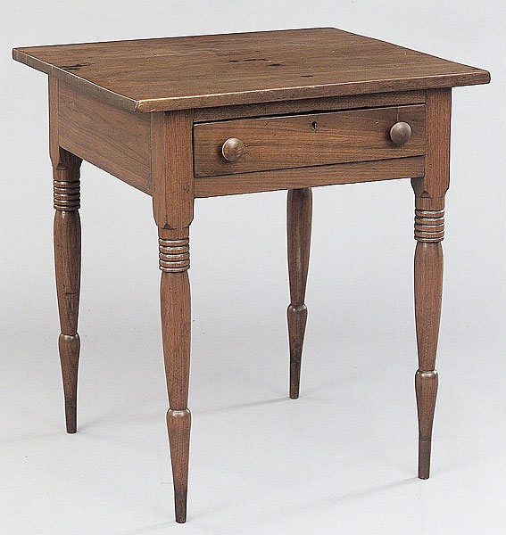 A Good American Walnut Table, mid-19th c., Southern, probably North Carolina, the rectangular top above a recessed frieze drawer, raising on ring-turned legs, height 29 in., width 25 1/2 in., depth 23 in.