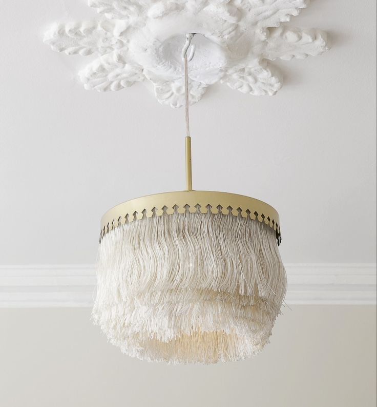 Hans-Agne Jakobsson, 1960's, Sweden | Ceiling light with fringes via The Apartment (DK)