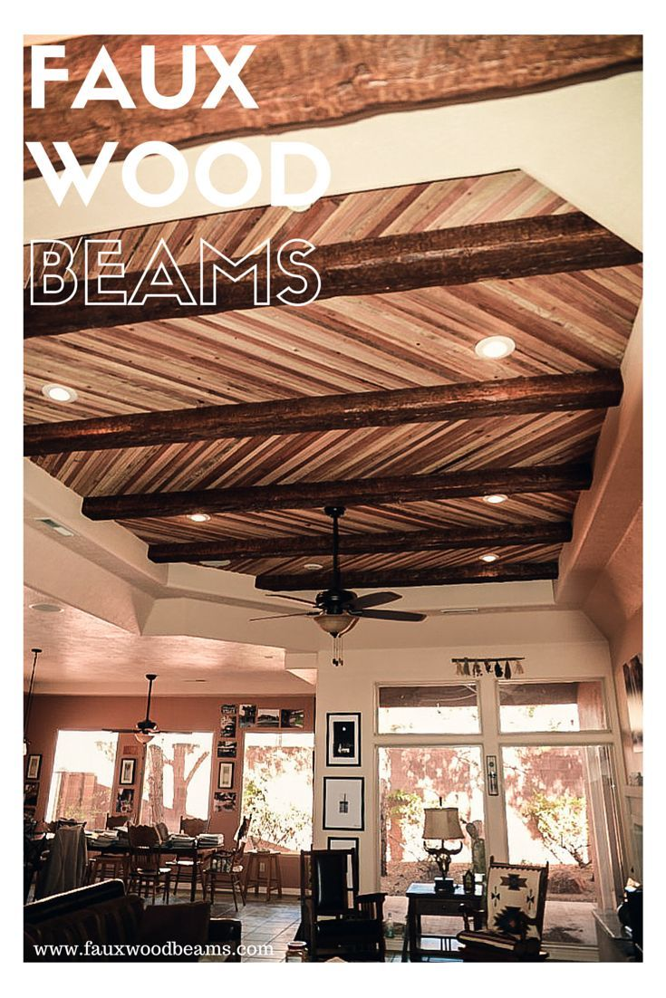 Open Plan Homes Ceiling Design Created With Real Wood Planks And Faux Beams Combined