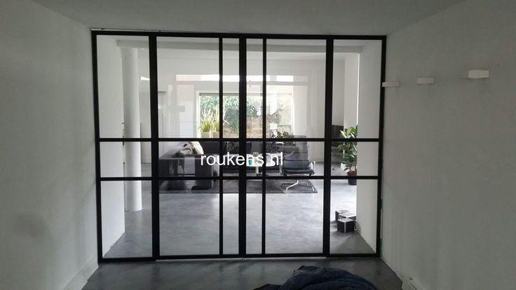 Deuren / Stalen glaswand met deuren en zijlichten
