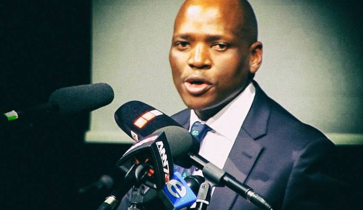 """TRAINSPOTTER: How Hlaudi Motsoeneng stole the news. As the Svengali behind the evolving disaster at the national broadcaster, no other single South African in a generation has had a greater hand in crafting our own version of Unreality. The looming local/global apocalypse? Relax, Hlaudi's got it """"covered"""". By RICHARD POPLAK.   Photo: Hlaudi Motsoeneng, a frame from TimesLive video."""
