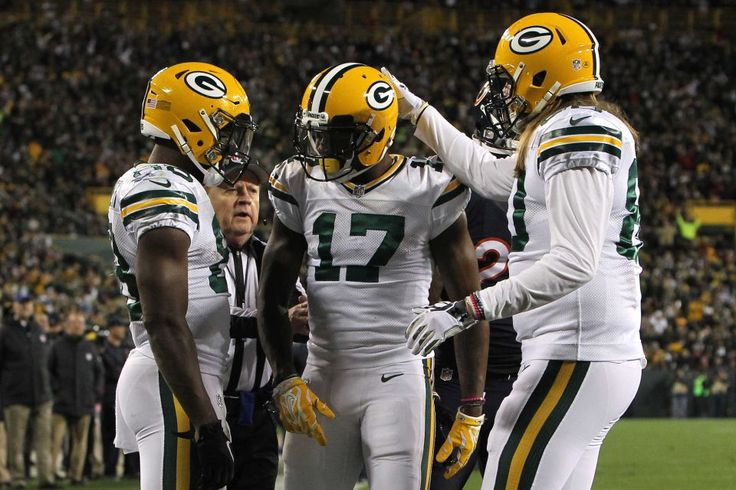 Thursday Night Football: Bears vs. Packers  -  October 20, 2016  -  26-10, Packers  - Wide receiver Davante Adams #17 of the Green Bay Packers celebrates with teammates wide receiver Ty Montgomery #88 and tight end Justin Perillo #80 after scoring a third quarter touchdown against the Chicago Bears at Lambeau Field on Oct. 20, 2016 in Green Bay, Wisconsin.