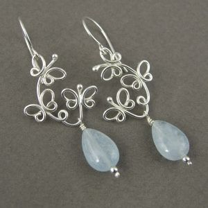 Fluttering Butterflies (2011) Sterling silver, aquamarine. Formed, flame-worked, cold-joined.