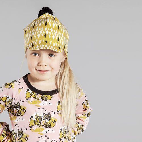 Yellow SALMIAKKI Cap http://en.nosh.fi/product/1271/salmiakki-cap-yellow and Powder pink ILVES dress http://en.nosh.fi/product/1281/ilves-dress-powder Prints designed by Finnish artist Annika Hiltunen