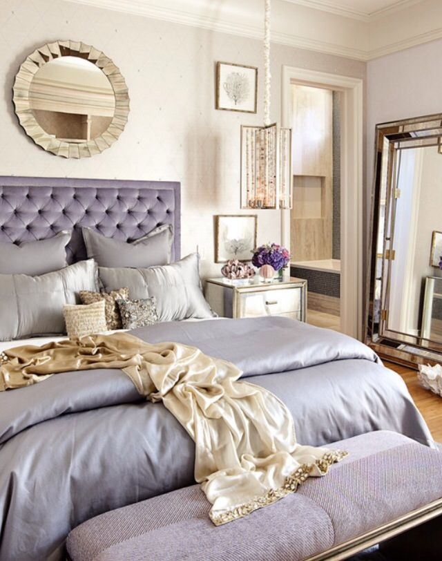 Simple way to incorporate gold with the gray, the overhead mirror and throw with small pillows