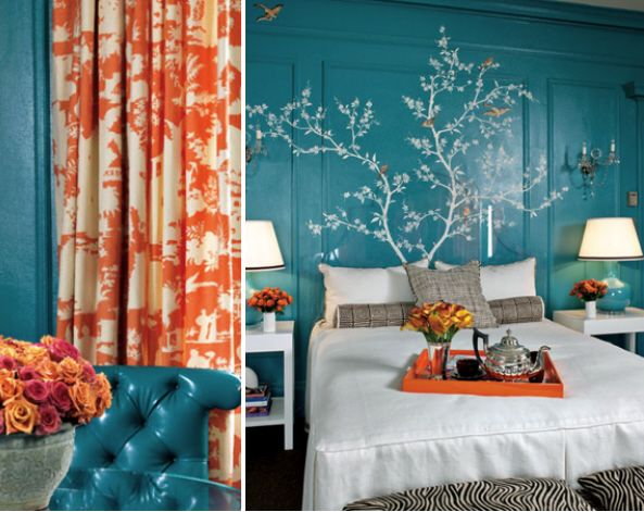 You'll often see orange paired with blue, they are complementary on the color wheel so they look especially good together.  I want to sleep in this bedroom!