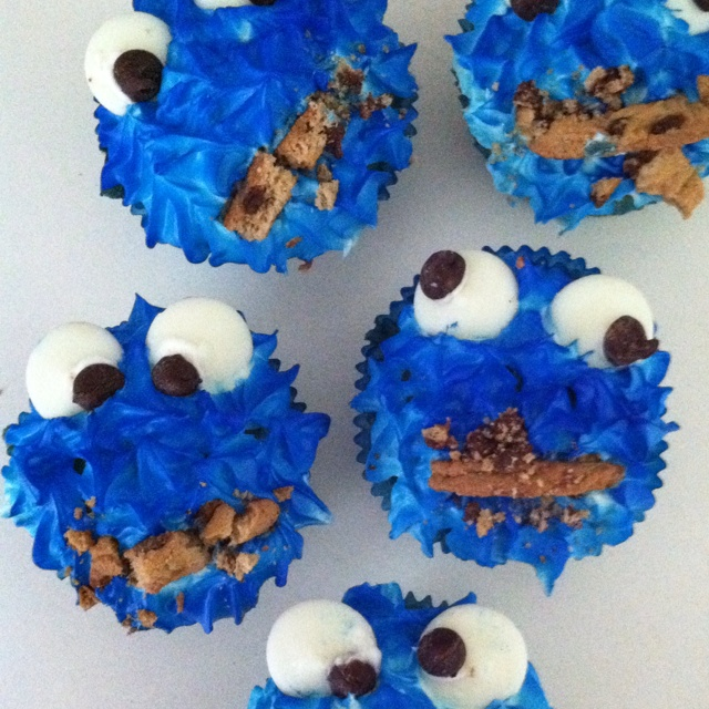 I made these adorable cookie monster cupcakes (originally pinned from here: www.withourbest.c... ).  They were EASY and FUN (my favorite combination LOL!) AND tasted great (important, or a bonus, your choice ;P )    Extra details: Best of all, my just-turned-3 year old son was able to help :)  he broke up the cookies for me and helped me spray paint (baker's paint) the cupcakes blue.  I like things that are interactive for them, because then I actually get a chance to do them!   So, notable…