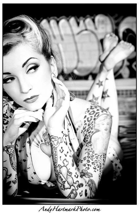 Love her Marilyn an cheetah print tattoos :) pin up style