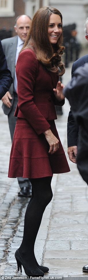 love the burgundy flared skirt with black tights