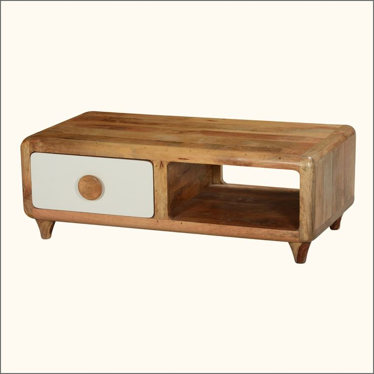 We mixed mod styles with the power of the ecology movement and created our 60's Natural line. The Rounded Corners TV Console Media Cabinet stands on tapered round short legs. One side features a drawer with a white front and a round wooden nob, the other side is a shelf with an open front and back. This modern take on a 60's entertainment island is built with solid mango wood, a tropical hardwood grown as a renewable crop.