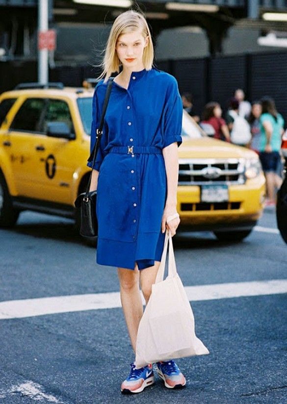 Dress down a bold colored dress with a pair of on-trend sneakers