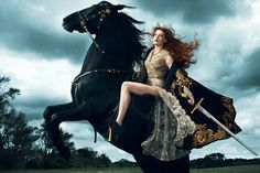 Florence Welch on horse with sword