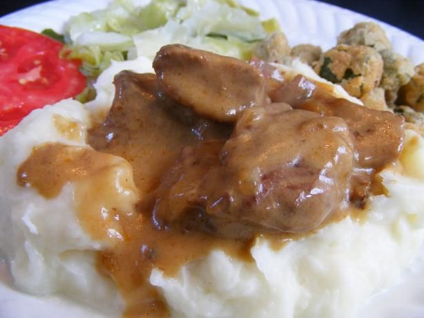 Crock Pot Beef Tips With Creamy Gravy from Food.com:   								So Easy!  Enjoy these beef tips at the end of a long day while they cook in your crock pot.  Great over rice, noodles or potatoes.  The gravy is made there for you.