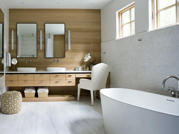 Natural wood vanity, marble wall, modern floating tub, organic materials in a modern esthetic