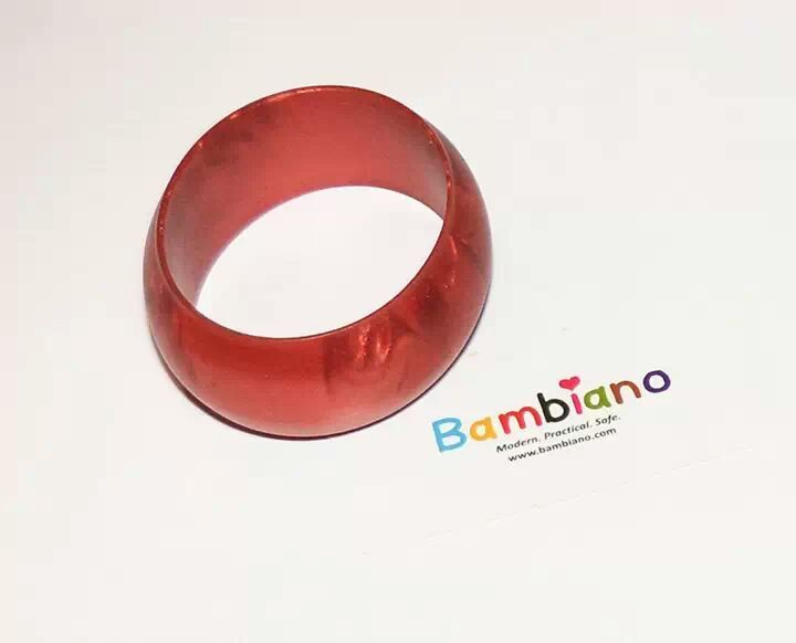 Bambiano Hoola Bangle in Metallic Red. Bambiano Bangles are made of 100% Food grade silicone. BPA free, Lead free and nontoxic. Fashionable for Mums and safe for teething babies to chew on. Bracelets are washable and soft on baby's gums. Shop at www.bambiano.com