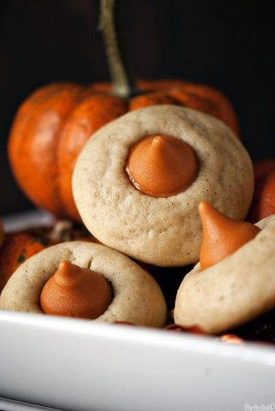 Chai Pumpkin Spice Thumbprints- Chai spice cookies with pumpkin Hershey Kisses.