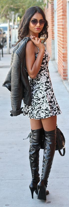 Womens Fashion - Sweet yet Sexy Date Night look. Love her over the knee leather boots paired with her skater print dress and leather jacket. Black And White Paisley Print Little Dress by Tuolomee