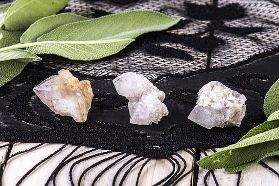 These three beautiful Spirit Quartz point clusters have incredible druzy sparkle. One has 3 distinct points, and the other two have 1 point each. 2 of the clusters are white in color, and the third has a lilac amethyst point. The left stone is Ametrine, meaning that both the amethyst and citrine colored crystals come together in the same stone.