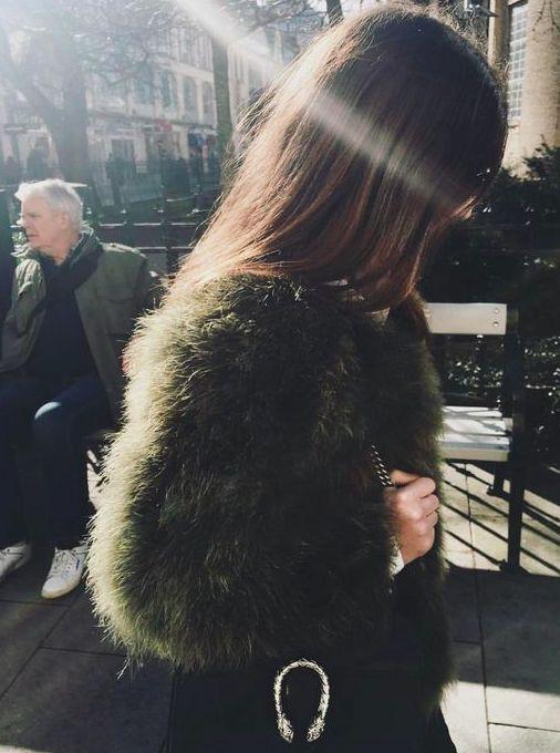 Dark green faux fur coat.