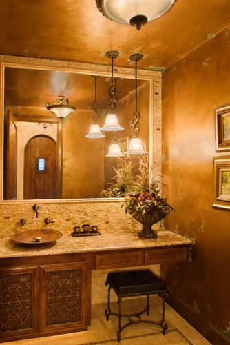 Mediterranean bathroom by Jenkins Custom Homes featuring Native Trails Maestro Mandala hand hammered copper vessel sink