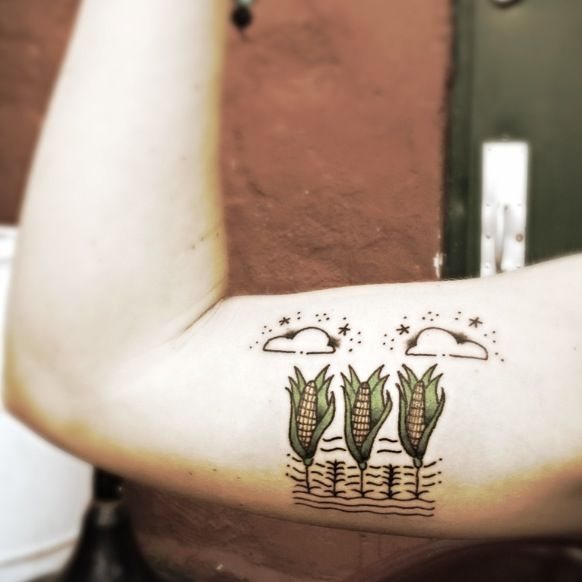 My corn and clouds tattoo in honor of the Midwest. :) Tattoo by Rush. Check him out on Instagram - mrush76