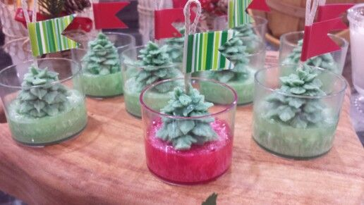 Palm wax candle with Christmas tree on them.