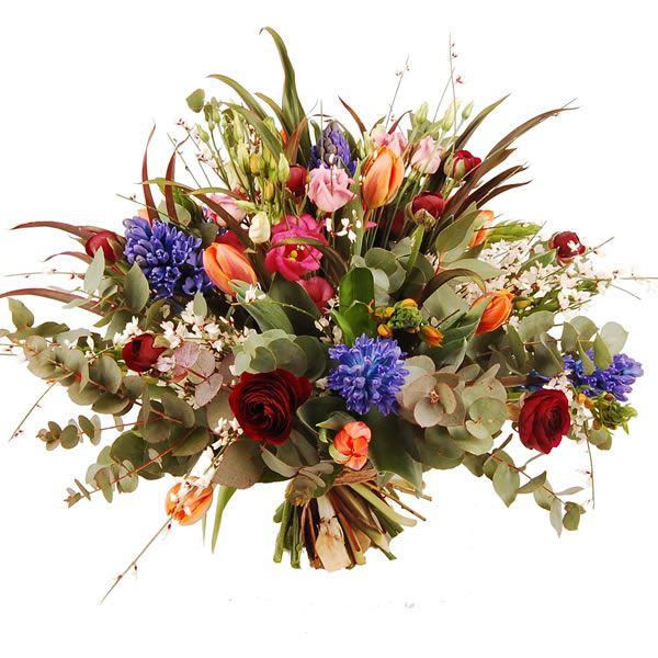 Het fleurigste boeket met oranje zuiderwind, blauwe annemonen, zeeuwsknoopje, ranonkels, hyacinten en div. groensoorten   Bestaat uit: rode ranonkels, zuiderwind, blauwe hyacinten, paarse annemoon, berengras en appelblad