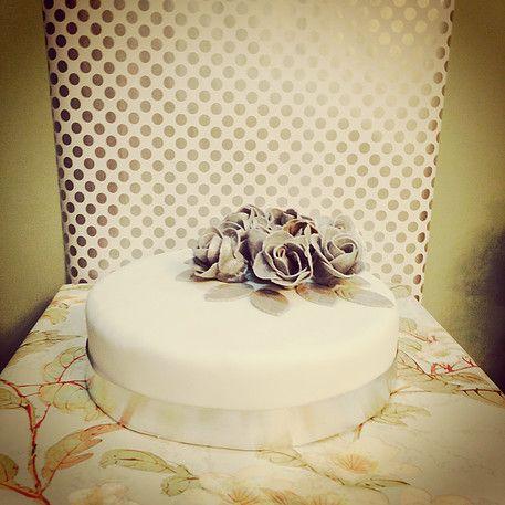 Wedding Cakes - Chocolate Truffle Fondant Wedding Cake   All Things Yummy   Chocolate Truffle Cake with White Fondant Art and Silver Edible Flowers  #allthingsyummy #wedding #cakes