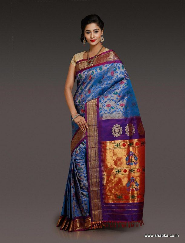 This Apoorva Brocaded Blue Paithani Silk Saree is adorned with patterns, capturing the very nature. The leaf branches and peacock motifs in silk and real zari threads on the border create a unique magic on the drape. This paithani silk saree with unique pattern worn on any occasion is sure to make you stand out.
