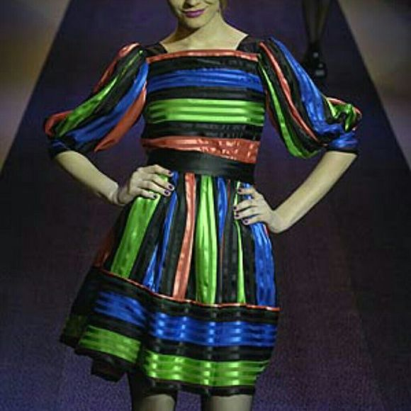 Betsey Johnson 2006 rare Dress Runway Unique Betsey Johnson Circus Striped Dress with puffed sleeves. From fall 2006 runway collection. Not sure if ever mass produced as I tried to locate it then and my local Soho BJ store didn't get it Eventually found at 06 Betsey sample sale.  lined, silky fabric.  Size 4, true to bj sizing. The arm hole openings are pretty slim and have buttons so probably best for slim arms.  Worn & loved. Has some minor snags in fabric. So cute styled Lolita or goth…