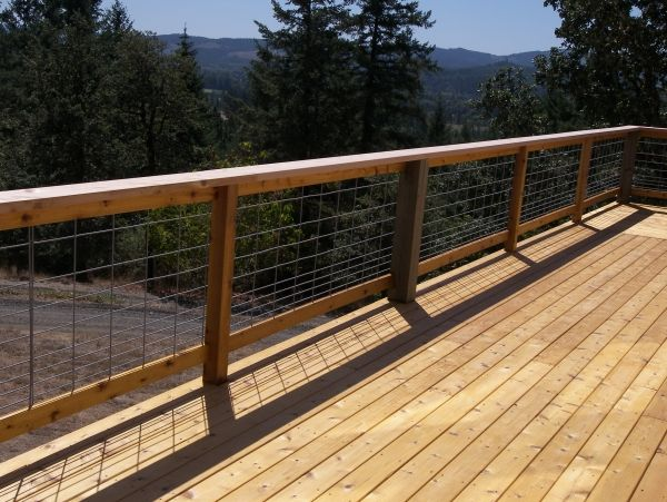 This cedar deck is surrounded by hog panel railing. Hog