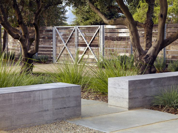 board-form concrete seat wall with plank fence I medlock Ames Tasting Room