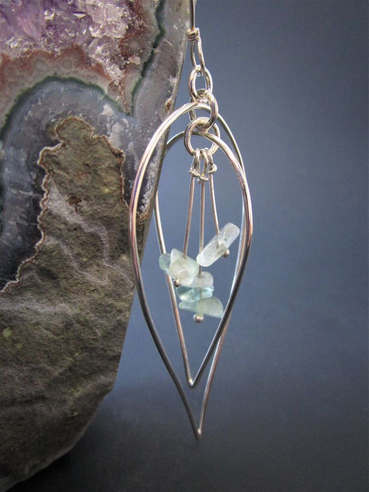 Anticlastic Earrings/ Leaf shape Sterling silver motif, with gorgeous blue/green Fluorite stones. Click the image to purchase on Etsy!