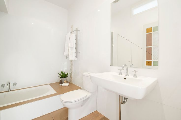 Modern main bathroom (shower above bath)