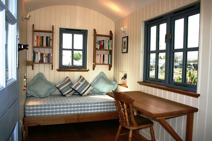 Shepherd's hut interior with desk and day bed