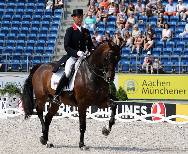 Carl Hester on Nip Tuck in their second championship producing a result that helped Great Britain to the European Championship team silver medal. © 2015 Ken Braddick/dressage-news.com