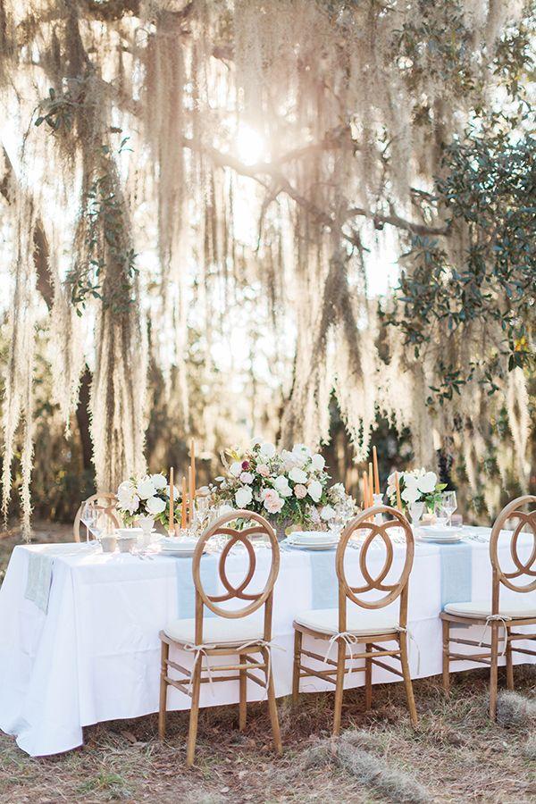 romantic wedding tables - photo by Jose & Teresa Photography http://ruffledblog.com/oldfield-plantation-wedding-inspiration